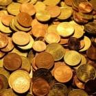 Wat bepaalt de waarde van een munt?